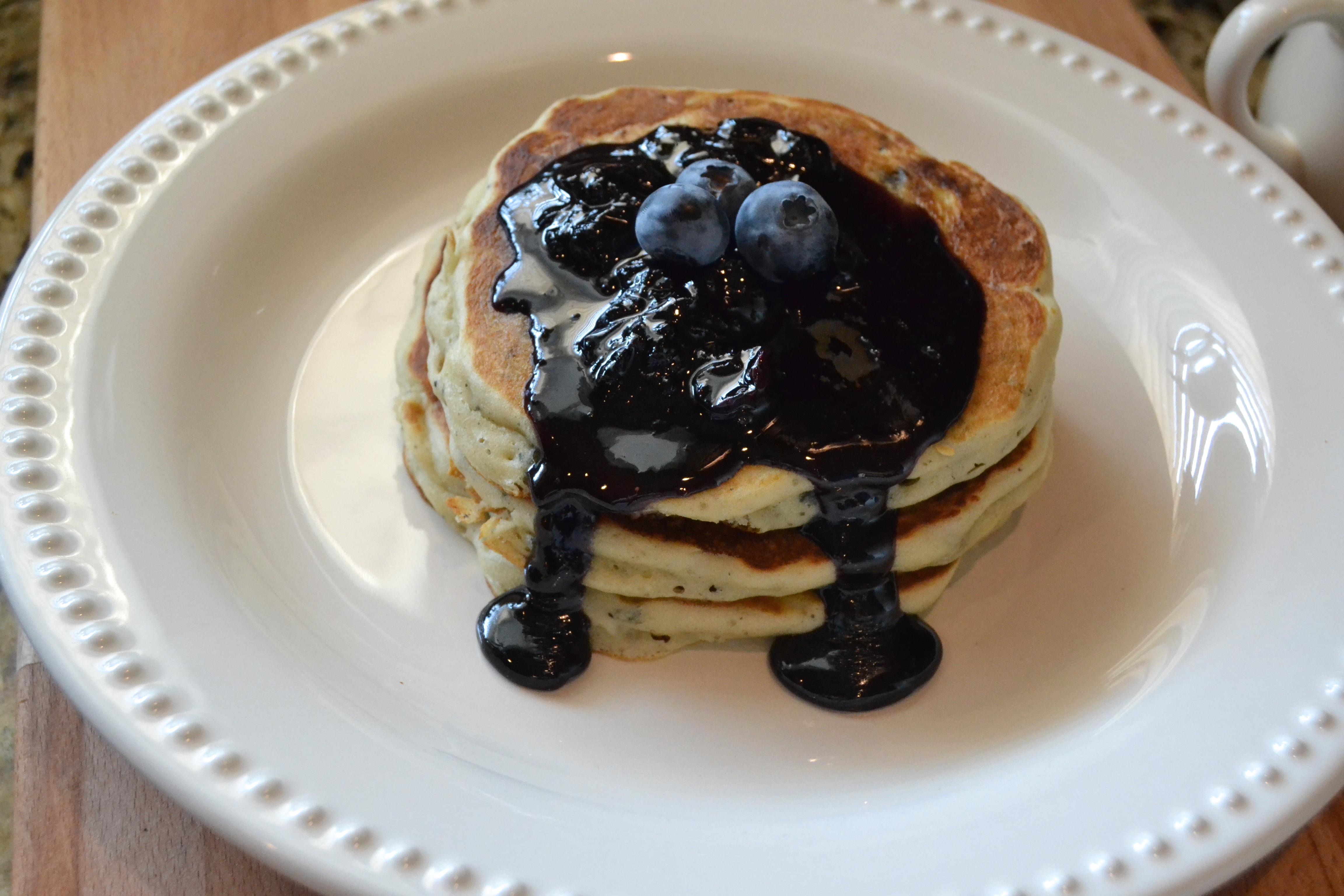 Sausage Blueberry Pancakes with a Blueberry Maple Syrup Reduction